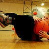 First grader Gavin Kempskie dives for a ball in gym class at Essex Elemetery School on Monday afternoon. Jesse Poole/Gloucester Daily Times Dec. 07, 2011