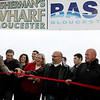 At the ribbon cutting for the new Base Gloucester fish auction mart at Fisherman's Wharf on Wednesday. From left are: Barry Pett of Sen. Bruce Tarr's office, Vito, Jenny, and Nick Giacalone, Gloucester Mayor Carolyn Kirk, Richie and Ray Canastra of New Bedford, Vito Giacalone, Jr. and behind the Canastra family, Chris and Marc Giacalone.