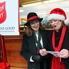 ALLEGRA BOVERMAN/Staff photo. Gloucester Daily Times. Manchester: The First Parish Church, Congregational, made a donation to the Salvation Army on Friday afternoon. Alice Eastland of Gloucester, left, a church member, presented the check to Ellen Petrilli, the Kettle Coordinator for the Cape Ann District, at Crosby's Market in Manchester. Petrilli said that she is extending the kettles through the end of next week, so volunteers who would like to continue ringing bells at the five locations (Crosby's Shop & Stop, Market Basket and the two Shaw's Supermarkets) in Cape Ann are welcome to reach her at 978-304-7767.
