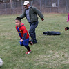 ALLEGRA BOVERMAN/Staff photo. Gloucester Daily Times. Gloucester: Wilson Emmanull DeLeon, Jr., left, 6, plays soccer with his grandparents, Hugo Ortiz, center and Erica Cortave, both visiting him from Austin, Texas,  on Tuesday afternoon at Mattos Field on Webster Street.