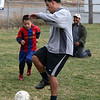 ALLEGRA BOVERMAN/Staff photo. Gloucester Daily Times. Gloucester: Wilson Emmanull DeLeon, Jr., left, 6, plays soccer with his father, Wilson DeLeon, center, and grandfather Hugo Ortiz, back right, visiting from Austin, Texas, on Tuesday afternoon at Mattos Field on Webster Street.