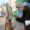 "Courtesy photo/Gloucester Daily Times. Rockport: Caleb Stone of Gloucester, and originally of Rockport, paints a watercolor in downtown Rockport on Thursday afternoon during the mild and sunny weather. He came to paint ""to take advantage of the warm day"" to do some plein air painting because it was such nice weather out. His watercolors and oil paintings are currently on display through part of January at Alchemy in downtown Gloucester."