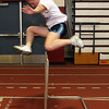 ALLEGRA BOVERMAN/Staff photo. Gloucester Daily Times. Gloucester: Gloucester High School indoor track team member Tiffany Pallazola, a junior, practices with the hurdles on Monday.