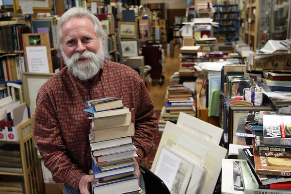 ALLEGRA BOVERMAN/Staff photo. Gloucester Daily Times. Gloucester: Bob Ritchie, longtime owner of Dogtown Books, on Main Street in Gloucester.