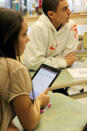 Allegra Boverman/Gloucester Daily Times. Manchester-Essex Regional High School students Teak Switzer and Ely Koufman were using iPads in their Business Management class on Tuesday during a unit on ethics.