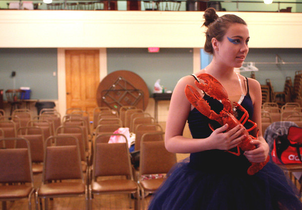 MARIA UMINSKI/GLOUCESTER DAILY TIMES Alicia Gibney holds onto her prop lobster during a dress rehearsal for The Lobstah Crackah at the American Legion on Wednesday. Gibney plays the Lobstah Pot Fairy in the production.