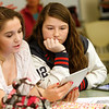 Allegra Boverman/Gloucester Daily Times. Manchester-Essex Regional High School students Allura Carbrey and Olivia Frontiero were using iPads in their Business Management class on Tuesday during a unit on ethics.