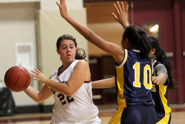Allegra Boverman/Gloucester Daily Times. Rockport's Heather MacArthur, left, in action against Greater Lowell Tech's Theresa Soy, right, on Tuesday evening.  Rockport lost 42-16.
