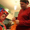 MARIA UMINSKI/GLOCESTER DAILY TIMES Director Henry Allen fits Sean Brown for one of his costume crab claws during a dress rehearsal for The Lobstah Crackah Ballet at the American Legion on Wednesday.