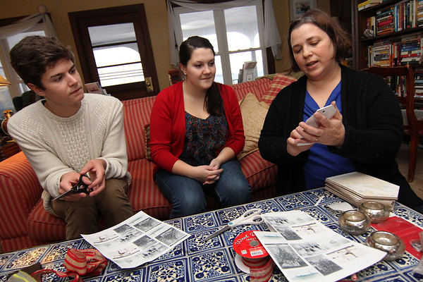 """Allegra Boverman/Gloucester Daily Times. From left are Tylor Hurst and Jenny Sonia, both Rockport High School seniors (Sonia is also a DECA member) helping interior designer Sarah Kelly of Rockport with her decorations she was making for an inn that will be taking part in the second SeaShells and Jingle Bells benefit featuring a holiday inn and house tour takes place on Saturday, Dec. 8 from 1p.m. to 5 p.m. featuring 12 homes and inns. Each site will feature a sampling of food or drink.  Proceeds support the Rockport High School DECA program and marketing classes. Tickets are available at: Rockport Inn and Suites at 183 Main St. and ToadHall Bookstore, both in Rockport, or online at<a href=""""http://seashellsandjinglebellsrkpt.blogspot.com/"""">http://seashellsandjinglebellsrkpt.blogspot.com/</a>."""