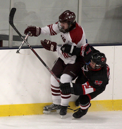 Jim Vaiknoras/Gloucester Times: Marblehead's Colin Daly checks Gloucester Ryan Whittemore during their game at the Talbot Rink in Gloucester during the Cape Anne Saving Bank 6th Annual Holiday Hockey Tournament.