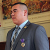 Allegra Boverman/Gloucester Daily Times. Adam Curcuru of Gloucester received a Purple Heart medal on Friday, at City Hall, for his injury during his service as a lead gunner in the Third Battalion Sixth Marines in Afghanistan.
