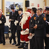 Jim Vaiknoras/Gloucester Times: Gloucester Firefighters sing carols, along with Santa, to residences at the Rose Baker Senior Center Monday.