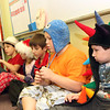 Allegra Boverman/Gloucester Daily Times. It was Crazy Hat Day at the Gloucester Community Arts Charter School on Friday. From front to back, listening to a math lesson from their teacher Brittany Rose, are: Griffin Towne, Ethen Brien, Joshual Amaral, Alexis Grammas, and Caleb Kent.