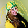 """Allegra Boverman/Gloucester Daily Times. Nikki Champagne, office manager at the Gloucester Community Arts Charter School, wore her """"super jellyfish"""" hat that actually belongs to her son, during Crazy Hat Day at the school on Friday."""