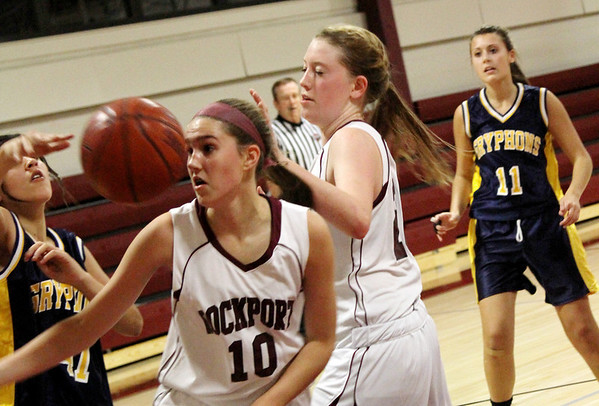 Allegra Boverman/Gloucester Daily Times. Rockport's Rachel Haselgard, second from left, and teammate Sarah Rowen, center right, in action against Greater Lowell Tech on Tuesday evening in Rockport. Rockport lost 42-16.