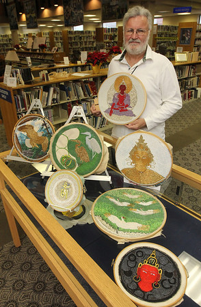 Allegra Boverman/Gloucester Daily Times. Bruce Ware, who recently moved to Gloucester, is displaying some of his intricate beadwork at Sawyer Free Library.