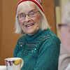 Jim Vaiknoras/Gloucester Times: JQuilter Barbara Maddox ejoys a laugh at the neighborhood quilting project Christmas party <br />  at the Rose Baker Senior Center Monday. Eight of their quilts are on display at the library, they are working on eight others.