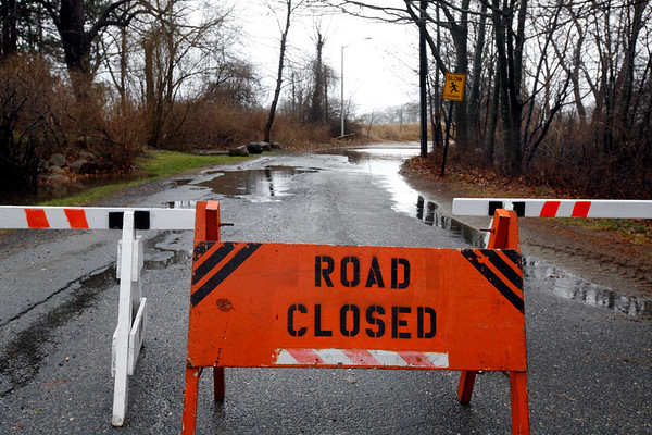 Allegra Boverman/Gloucester Daily Times. Ocean Street in Manchester was closed at both ends during the rainstorm on Thursday. The beaches there were damaged in the storm and were being repaired.