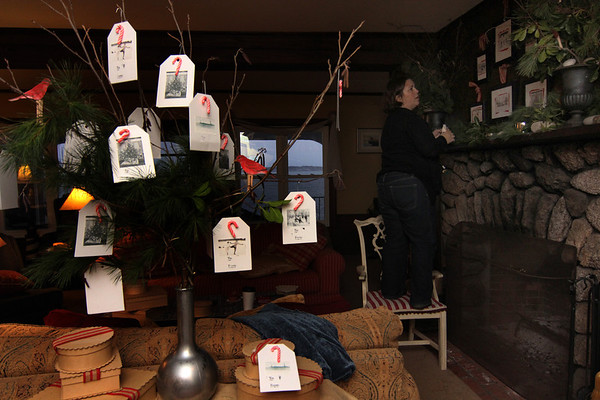 """Allegra Boverman/Gloucester Daily Times. Sarah Kelly, an interior designer from Rockport, decorates an inn in Rockport that will be participating in the second SeaShells and Jingle Bells benefit featuring a holiday inn and house tour takes place on Saturday, Dec. 8 from 1p.m. to 5 p.m. featuring 12 homes and inns. Each site will feature a sampling of food or drink.  Proceeds support the Rockport High School DECA program and marketing classes. Tickets are available at: Rockport Inn and Suites at 183 Main St. and ToadHall Bookstore, both in Rockport, or online at<a href=""""http://seashellsandjinglebellsrkpt.blogspot.com/"""">http://seashellsandjinglebellsrkpt.blogspot.com/</a>."""