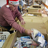 Allegra Boverman/Gloucester Daily Times. Ray Fisher of Gloucester was helping to pack up care packages for eight soldiers serving in Afghanistan for the holidays at the Office of Veterans Service on Wednesday morning. He was putting toiletries of all kinds in the boxes, including shampoo, deoderant, toothpaste, wipes and so on.