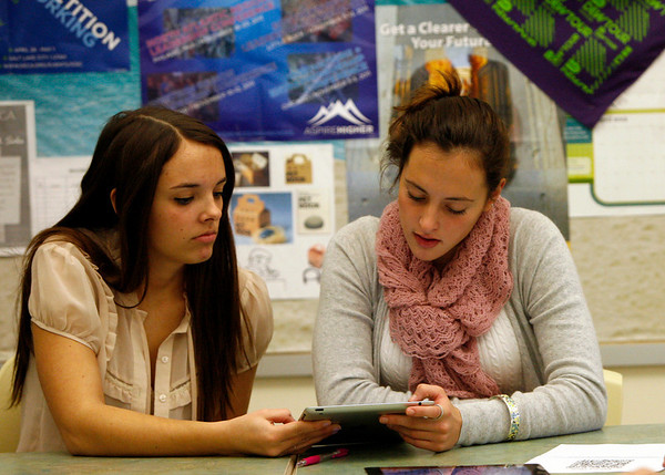 Allegra Boverman/Gloucester Daily Times. Manchester-Essex Regional High School students Teak Switzer and  Ellie Mortillaro  were using iPads in their Business Management class on Tuesday during a unit on ethics.
