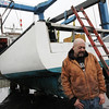 "Allegra Boverman/Gloucester Daily Times. Capt. Dave Marciano's boat, ""Hard Merchandise"" became submerged in its slip at Gloucester Marine Railways over the weekend. Marine Services of Salisbury lifted it up and out of the water."