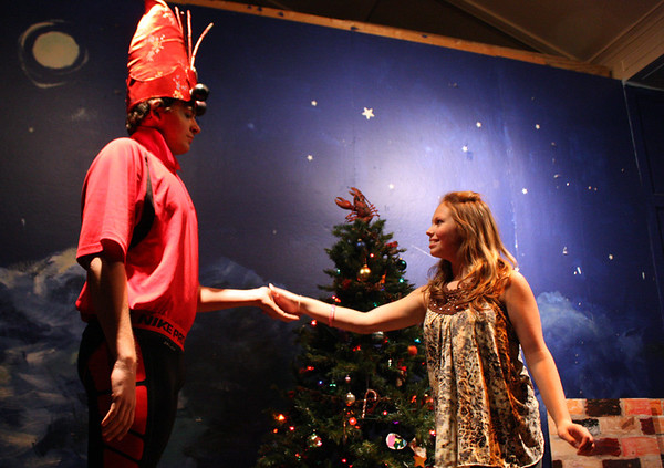 MARIA UMINSKI/GLOUCESTER DAILY TIMES Olivia Danjou, as Clarafied, takes the hand of the Lobstah Crackah Prince, as played by Richard Crowell, during the dress rehearsal of Henry Allen's North Shore Folklore Theatre Company's production of The Lobstah Crackah Ballet at the American Legion on Wednesday.