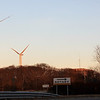 Allegra Boverman/Gloucester Daily Times. The third turbine at Blackburn Industrial Park, at Gloucester Engineering, is now fully installed, far left, as of midafternoon on Thursday.