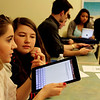 Allegra Boverman/Gloucester Daily Times. Manchester-Essex Regional High School students Allura Carbrey and Olivia Frontiero were using iPads in their Business Management class on Tuesday during a unit on ethics. In back from left, are classmates Austin Waldsmith, Taylor Ketchum, Maddie Monagle and Gina Santo.