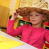 Allegra Boverman/Gloucester Daily Times. It was Crazy Hat Day at the Gloucester Community Arts Charter School on Friday. Kindergartener Lola Prendergast was wearing her hat proudly.