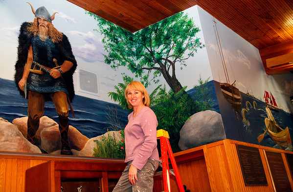 Allegra Boverman/Gloucester Daily Times. Tina Lamond, who works at Rockport Elementary School, has been working on a mural in the main lobby at Rockport High School depicting the school's mascot and local scenery, history and ships. She usually paints after school and at night when there is less traffic in the hallway.