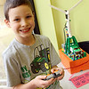 Allegra Boverman/Gloucester Daily Times. Cowan Sweeney, a Gloucester Community Arts Charter School third grader, proudly shows off the battery powered Lego turbine he built that is on display in his classroom at the school. The school is in the Blackburn Industrial Park, and the three wind turbines are in very close proximity to the campus.