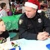 Allegra Boverman/Gloucester Daily Times. The Rockport Police Department served lunch to Rockport Elementary School students on Thursday, the second year they have done so. Leftovers from the lunch, which included turkey, stuffing, mashed potatoes, gravy, cranberry sauce, string beans and rolls, were brought to the Action homeless shelter in Gloucester immediately following. Officer Bill Budrow, right, spends some quality time with his daughter, Samantha Budrow, a fifth grader.