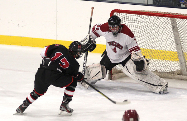 Jim Vaiknoras/Gloucester Times: Marblehead's Dean Fader scores Gloucester goalie Jesse Glidden during their game at the Talbot Rink in Gloucester during the Cape Anne Saving Bank  6th Annual Holiday Hockey Tournament.