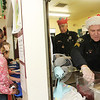 Allegra Boverman/Gloucester Daily Times. The Rockport Police Department served lunch to Rockport Elementary School students on Thursday, the second year they have done so. Leftovers from the lunch, which included turkey, stuffing, mashed potatoes, gravy, cranberry sauce, string beans and rolls, were brought to the Action homeless shelter in Gloucester immediately following. Noelle Syrigos McGinn, left, a fourth grader, awaits her tray of lunch being prepared by Sgt. Bob Tibert at far right, and Special Officer Roger Lesch, behind him.
