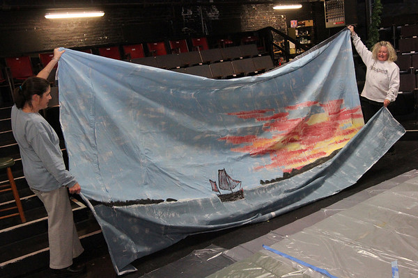 "Allegra Boverman/Gloucester Daily Times. Lanesville artist Camilla MacFadyen, left, and volunteer Pia Nadel, also of Lanesville, have been painting the sets for the upcoming ""Holiday Delights"" production by the Youth Acting Workshops at Gloucester Stage Company, 267 E. Main St.. The musical show will be performed on Thursday and Friday, Dec. 13 and 14 at 7 p.m., Saturday, Dec. 15 at 3 and 7 p.m., and Sunday, Dec. 16 at 3 p.m."