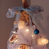 """Allegra Boverman/Gloucester Daily Times. Detail of a shell-themed tree in the guesthouse of a Rockport home that will be on display this weekend at the second SeaShells and Jingle Bells benefit featuring a holiday inn and house tour takes place on Saturday, Dec. 8 from 1p.m. to 5 p.m. featuring 12 homes and inns. Each site will feature a sampling of food or drink.  Proceeds support the Rockport High School DECA program and marketing classes. Tickets are available at: Rockport Inn and Suites at 183 Main St. and ToadHall Bookstore, both in Rockport, or online at<a href=""""http://seashellsandjinglebellsrkpt.blogspot.com/"""">http://seashellsandjinglebellsrkpt.blogspot.com/</a>."""