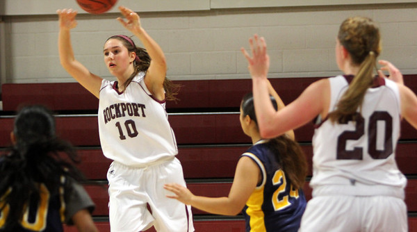 Allegra Boverman/Gloucester Daily Times. Rockport's Rachel Haselgard, left, and teammate Sarah Rowen, far right, in action against Greater Lowell Tech on Tuesday evening in Rockport. Rockport lost 42-16.