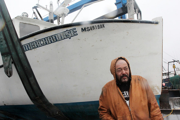 Allegra Boverman/Gloucester Daily Times. Capt. Dave Marciano's boat became submerged in its slip at Gloucester Marine Railways over the weekend. Marine Services of Salisbury lifted it up and out of the water.