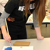 Allegra Boverman/Gloucester Daily Times. Manchester Essex Regional High School junior Maddie Pomeron paints a real flounder to make a print  during a two day workshop with visiting artist Joseph Higgins of Salem.