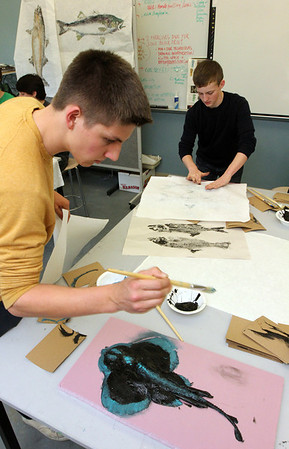 Allegra Boverman/Gloucester Daily Times. Calvin Lamothe, left, a Manchester Essex Regional High School senior, and Chris Carr, a freshman, right, work on making fish prints from real specimens during a  two day workshop with visiting artist Joseph Higgins of Salem.