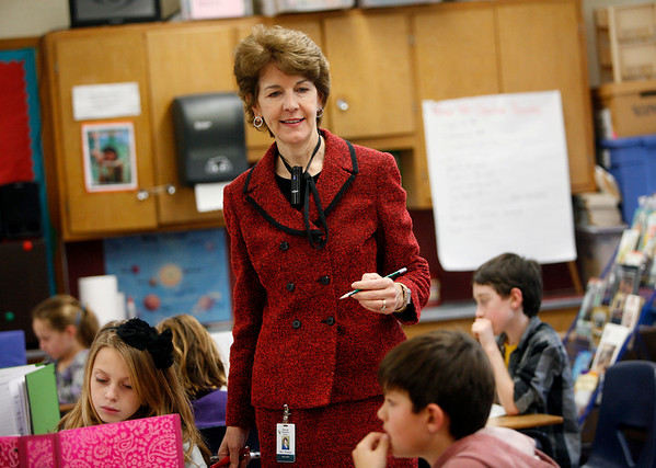 Allegra Boverman/Gloucester Daily Times. Manchester Memorial Elementary School third grade teacher Pat Fleming wears a microphone connected to a new sound system in her classroom to help amplify her voice.