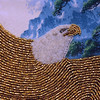 Allegra Boverman/Gloucester Daily Times. Bruce Ware, who recently moved to Gloucester, is displaying some of his intricate beadwork at Sawyer Free Library. This is a detail of a piece depicting a bald eagle in flight.