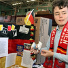 Allegra Boverman/Gloucester Daily Times. St. Ann Middle School eighth grader Enzo Paganetti discusses the customs and culture of Germany, where his parents are from, during the Heritage Fair at the school on Tuesday. The middle school students have spent time studying countries where they have ancestors and family or are from themselves, and put on display information about their cultures, customs, made food native to those countries and discussed how Christmas is celebrated in those countries. The students and teachers also created a cookbook with 40 recipes from around the world and proceeds from the cookbook sales will fund middle school activites for next year.