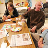 Allegra Boverman/Gloucester Daily Times. The Grace Center, Inc. held a celebration of its first year on Wednesday. From left, chatting during the event, are volunteer Claire Whitten and guest David Ruben, guest Blake  Beath and volunteer Bill Chapin.