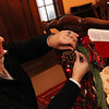 """Allegra Boverman/Gloucester Daily Times. Sue Andersen of Rockport working on a chair decoration in the dining room of a 1920s-style home in Rockport that will be part of the second SeaShells and Jingle Bells benefit featuring a holiday inn and house tour takes place on Saturday, Dec. 8 from 1p.m. to 5 p.m. featuring 12 homes and inns. Each site will feature a sampling of food or drink.  Proceeds support the Rockport High School DECA program and marketing classes. Tickets are available at: Rockport Inn and Suites at 183 Main St. and ToadHall Bookstore, both in Rockport, or online at<a href=""""http://seashellsandjinglebellsrkpt.blogspot.com/"""">http://seashellsandjinglebellsrkpt.blogspot.com/</a>."""