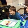 Allegra Boverman/Gloucester Daily Times. The Rockport Police Department served lunch to Rockport Elementary School students on Thursday, the second year they have done so. Leftovers from the lunch, which included turkey, stuffing, mashed potatoes, gravy, cranberry sauce, string beans and rolls, were brought to the Action homeless shelter in Gloucester immediately following.  Patrolman Sean Andrus kids around with fourth graders Tyler Abell, center and Kamron Diaz.