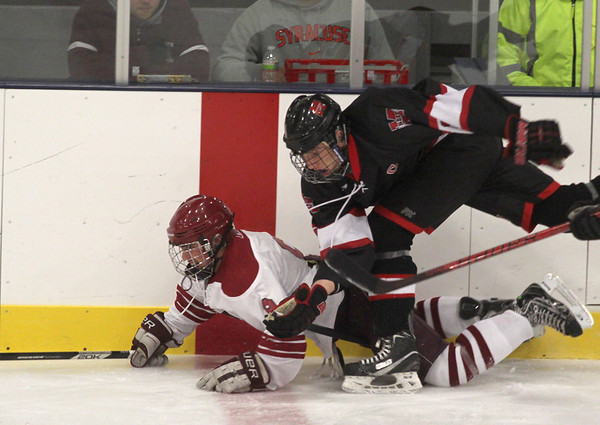 Jim Vaiknoras/Gloucester Times: Marblehead's Ian Maag checks Gloucester's Casey Noyes during their game at the Talbot Rink in Gloucester during the Cape Anne Saving Bank  6th Annual Holiday Hockey Tournament.
