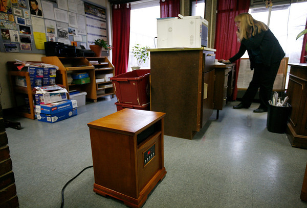 Allegra Boverman/Gloucester Daily Times. This space heater, bottom center, is one of two in this office space within the Gloucester Public Schools Transportation Department in the Fuller School building. Kathy Verga, the department's manager, is in the background.